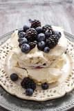 Fototapety Pavlova cake with blueberries and blackberries
