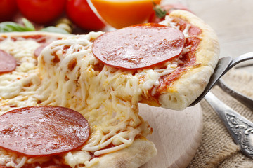 Italian cuisine: pizza with salami