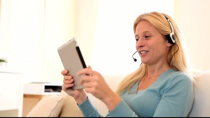 Young attractive woman blonde chatting on tablet