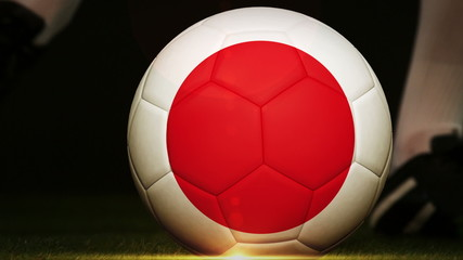 Football player kicking japan flag ball
