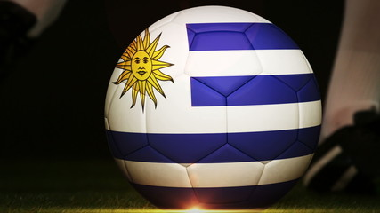 Football player kicking uruguay flag ball