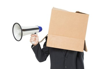 Businessman with box on head holding megaphone