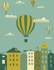 Hot air balloons flying over the town
