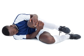 Football player lying down injured