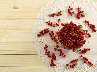 Red currant on lace napkin