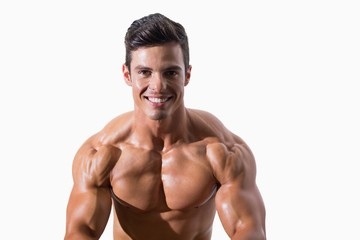 Portrait of a smiling shirtless muscular man