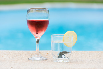 Glass of wine and water in the pool