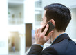 Young business talking on mobile phone