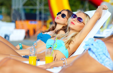 beautiful girls sunbathing on summer vacation
