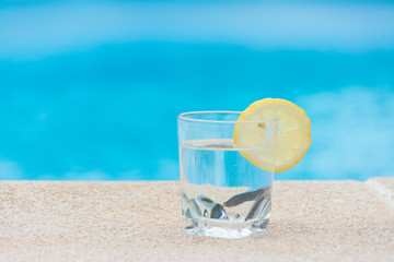 Glass of water in the pool