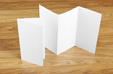 Blank folding page booklet on wooden background