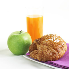 Healthy Breakfast with orange juice croissant and apple