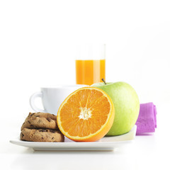 Healthy Breakfast with coffee, orange, apple and cookie