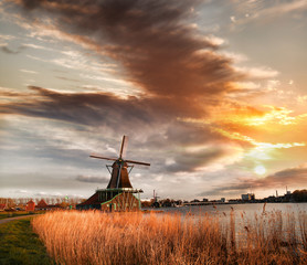Traditional Dutch windmills with canal near the Amsterdam, Holla