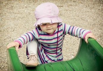 Little girl and playground slide