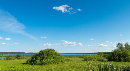 Summer landscape of meadow lake and sky
