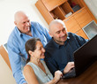 advisor   near mature couple with laptop