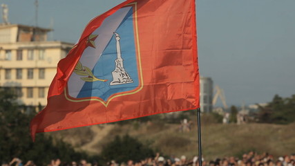 Flag of Sevastopol fly over the crowd