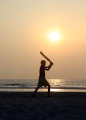 Junge spielt Cricket