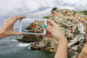 Riomaggiore photographing with mobile phone