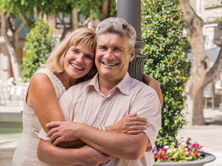Romantic smiling mature healthy romantic middle-aged couple