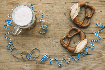 Oktoberfest: Masskrug of beer, Pretzels and bavarian streamer
