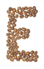 Letter E arranged from coffee beans top view isolated