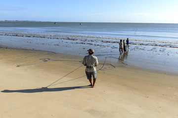 Fishermen hauling the net, Pititinga (Brazil)
