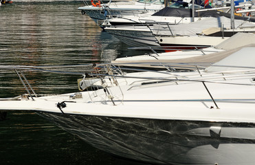 Bows of motorboats in a marina or harbor