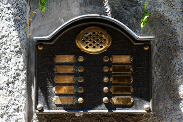 Brass intercom plate at an entrance