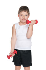 Confident young boy with dumbbells