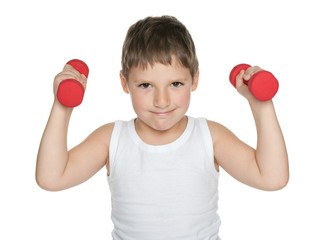 Confident boy with dumbbells