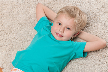 Cute smiling little boy resting