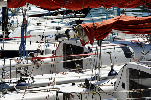 Sailing boats moored in a harbor
