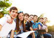 Group of students or teenagers with notebooks outdoors - 67623250