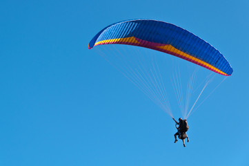 Blue Paraglider in Blue Sky