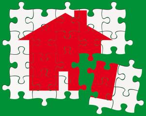 maison rouge sur puzzle, fond vert
