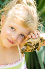 beautiful blond girl with turtle