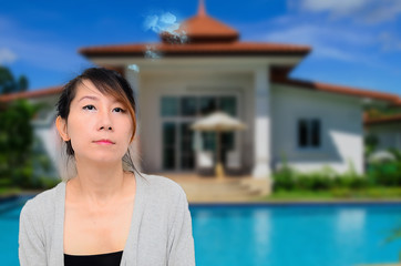 Thoughtful Smart Asian Woman In Front of House Looking up and to