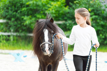 Girl and pony for a walk