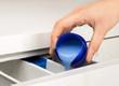 hand pouring liquid detergent