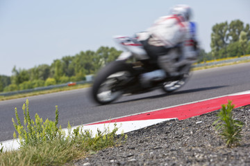 Motorcycle racer on circuit