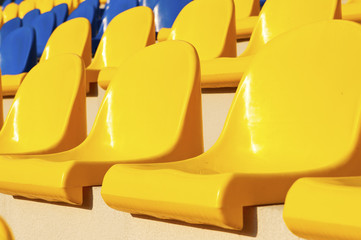 Empty blue and yellow seats in stadium