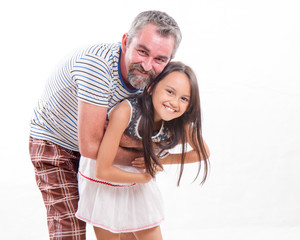 Caucasian dad hugging asian daughter