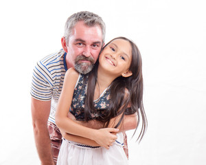 Caucasian dad holding Asian daughter