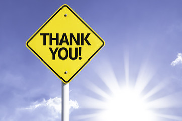 Thank you road sign with sun background