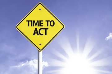 Time to Act road sign with sun background