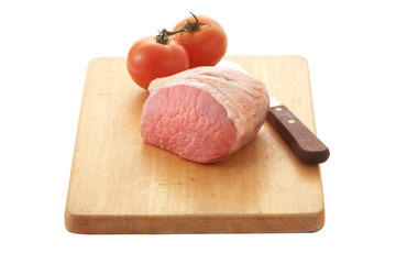 porkchop and tomato on wooden tray