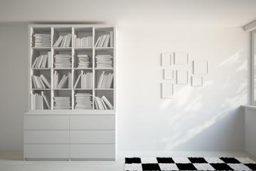 Bücherregal und Bilderrahmen an Wand