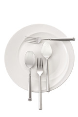 spoon and fork in white ceramic dish on white background